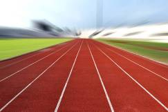 Running Track At A Sport Stadium (radial blur up image)